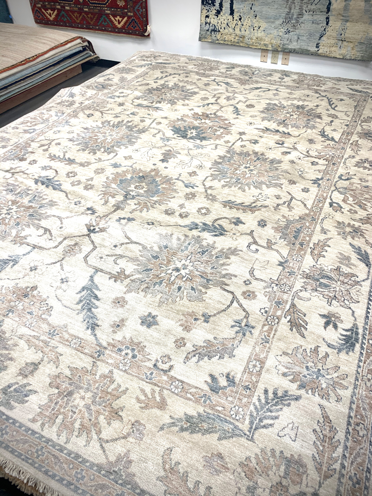 Cream colored traditional rug with floral print from India