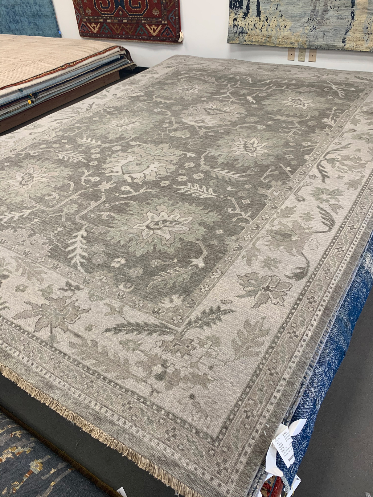 Grey colored traditional rug with floral print from India