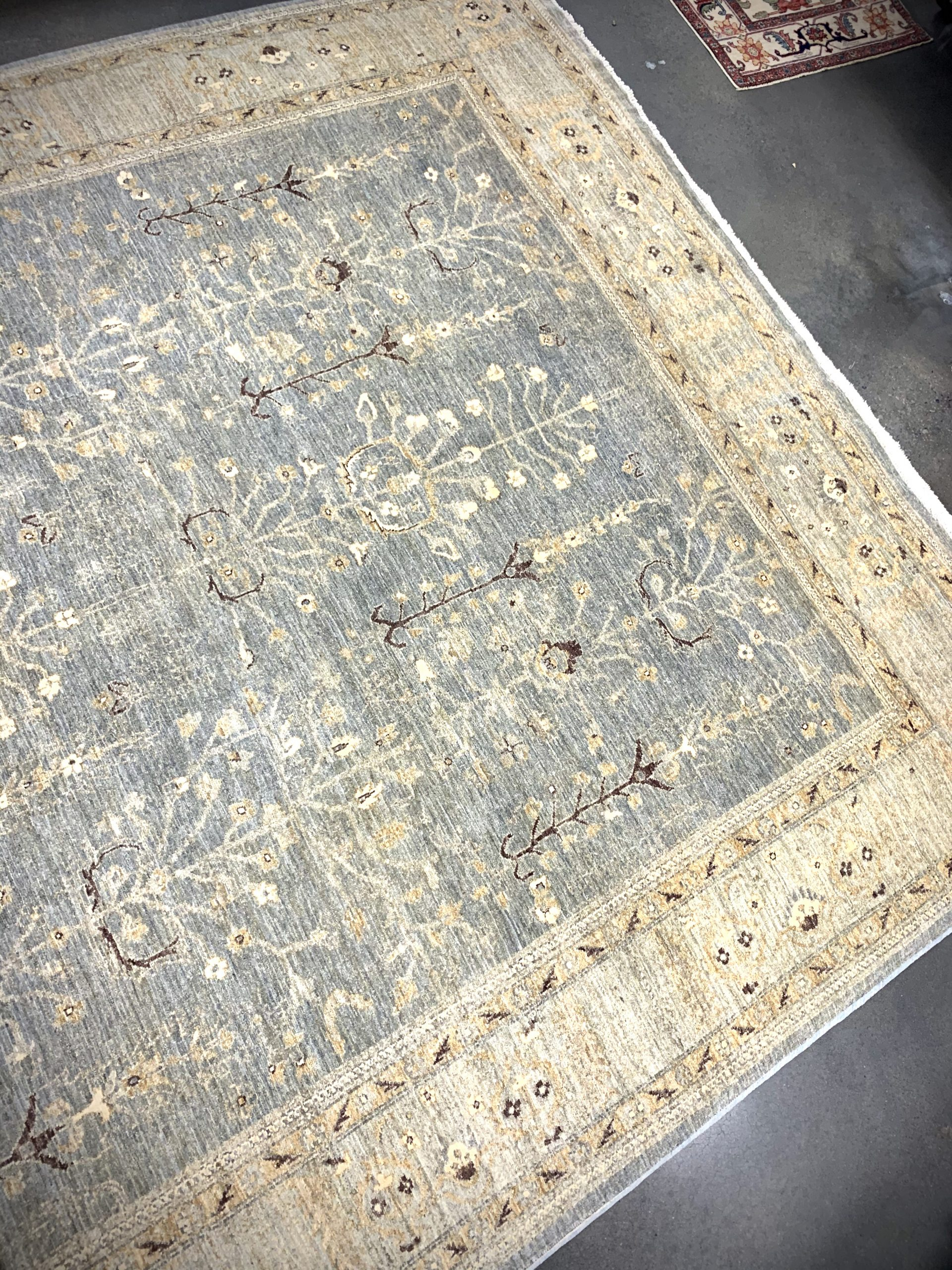 Light gray, gold, and brown hand knotted traditional area rug from Pakistan with silk highlights